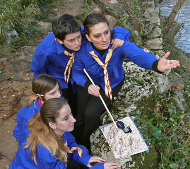 Scouts studying                         map at The Border Hike